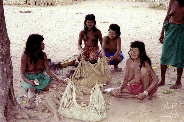 Three generations of Ramkokamekrá Canela women begin to process manioc. photo: Jean Crocker, 1990.