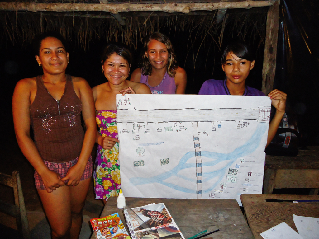 Girls from the village of Aperoi with a map of the traditional territory. Photo: Felipe Vander Velden, 2013.